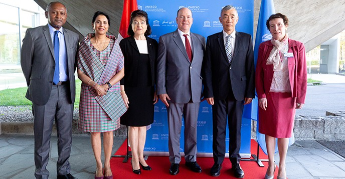 H.S.H. Prince Albert II of Monaco, Kathryn Waler, IUGG President, and guests are greeted by Xing Qu, Deputy Director-General of UNESCO, and Shamila Nair-Bedouelle, UNESCO Assistant Director-General for the Natural Sciences.